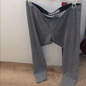 Grey Nike leggings with black Nike on the back